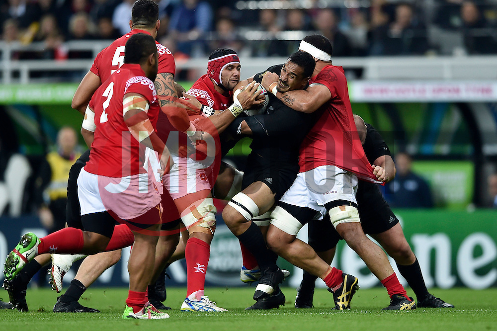 Jerome Kaino of New Zealand is tackled - Mandatory byline: Patrick Khachfe/JMP - 07966 386802 - 09/10/2015 - RUGBY UNION - St James' Park - Newcastle, England - New Zealand v Tonga - Rugby World Cup 2015 Pool C.