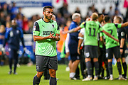 AFC Wimbledon defender Rod McDonald (4) goes to thank the travelling fans during the EFL Sky Bet League 1 match between Ipswich Town and AFC Wimbledon at Portman Road, Ipswich, England on 20 August 2019.