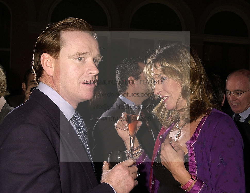 MR JAMES HEWITT, a former close friend of Diana, princess of wales and MRS KATE SIMON, at a reception in London on 13th November 2000.OJA 97