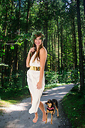 Greek Goddess with dog in a lush forest