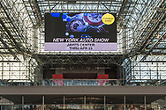 "Manhattan, New York, USA. April 12, 2017.  Message of ""NEW YORK AUTO SHOW, Jaivts Center, Thru Apr 23, @citybuzzTEVENt"" shows on large electronic sign near 4th Floor ceiling of Javits Center during the New York International Auto Show 2017, NYIAS, Press Day."