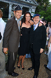 Left to right, PAUL & TRICIA SIMONON and STEPHEN JONES at a party to celebrate Stephen Jones's 25 Years of Millinery held at Debenham House, 8 Addison Road, London W14 on 13th July 2006.<br />