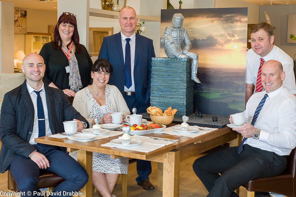 Left to right Events Fundraiser Ash Corker, Rotherham Hospice Fundraising Team Leader Anne Giblin, Cake Artist Rose Dummer, Oak Furniture Land Rotherham Store Manager Jez Groom, and Sales Advisors Ryan Jones and Paul Senior enjoy a Celebration Breakfast with Man of Steel at the opening of the Oak Furniture Land Rotherham Store. The cake will be donated to Rotherham Hospice who will use it to help raise funds<br /> <br /> 3 June 2015<br />  Image © Paul David Drabble <br />  www.pauldaviddrabble.co.uk