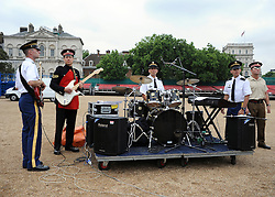 © licensed to London News Pictures. LONDON, UK.  06/06/11. The USA Army Band, joined by a guitar player from the Scot's Guards on Horse Guards Parade. The United States Army Band join with the Massed Bands and Corps of Drums of the Household Division to rehearse Beat Retreat at Horse Guards Parade. The event takes place on 8th and 9th June for featuring the US band the first time. The US visit comes two weeks after the State visit to London of the US President..  Photo credit should read Stephen Simpson/LNP