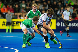 Germany's Florian Fuchs is tackled by Ronan Gormley of Ireland. Ireland v Germany - Unibet EuroHockey Championships, Lee Valley Hockey & Tennis Centre, London, UK on 23 August 2015. Photo: Simon Parker