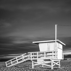 Lifeguard tower 1550 at night in Santa Monica California.  Photo is black and white, vertical and high resolution. Copyright ⓒ 2017 Paul Velgos with All Rights Reserved.