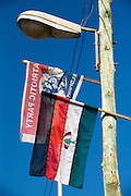 Banners of the New Patriotic Party (NPP), top, and National Democratic Congress (NDC) hanging from a light post ahead of presidential elections in Cape Coast, Ghana on Saturday September 6, 2008.