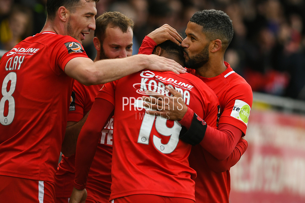 Jobi McAnuff of Leyton Orient (7) kisses the head of Josh Koroma of Leyton Orient (19) after Koroma assisted both of McAnuff's goals, this goal making it 0-3 during the Vanarama National League match between Harrogate Town and Leyton Orient at Wetherby Road, Harrogate, United Kingdom on 22 September 2018.