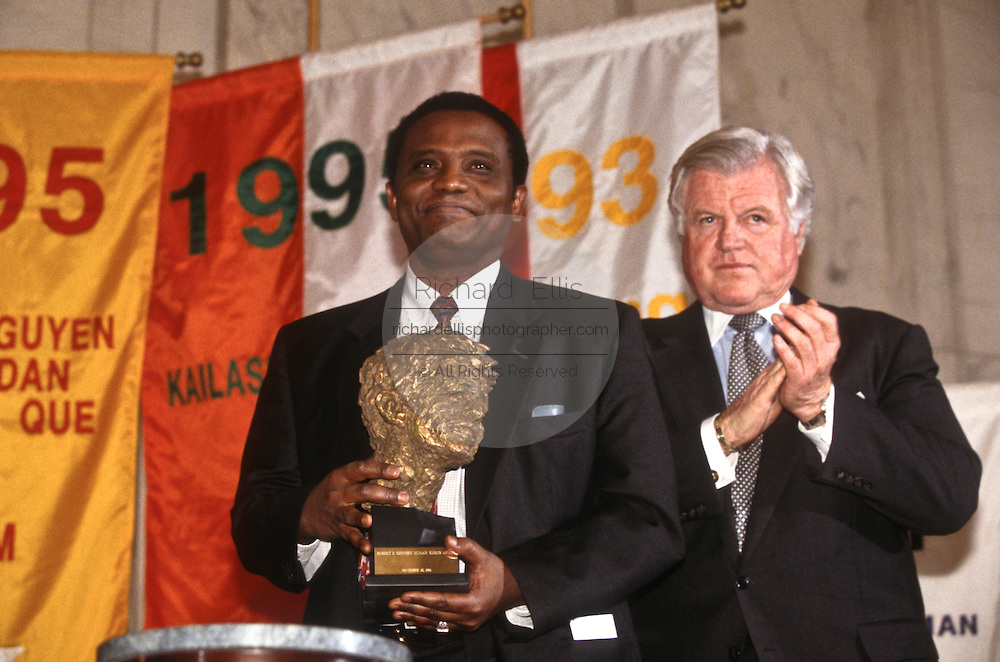 Abdullahi An-Na'im accepts the Robert F. Kennedy Human Rights Award from Senator Ted Kennedy on behalf of an anonymous human rights activist in Sudan November 27, 1996 in Washington, DC. The award is presented annually to individuals who stand up to oppression in pursuit of respect for human rights.