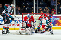 KELOWNA, CANADA - MARCH 13: Bailey Brkin #31 makes a save as Egor Arbuzov #42 of the Spokane Chiefs checks Leif Mattson #28 and Nolan Foote #29 of the Kelowna Rockets tries to shoot the rebound on March 13, 2019 at Prospera Place in Kelowna, British Columbia, Canada.  (Photo by Marissa Baecker/Shoot the Breeze)