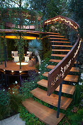 Belvedere in the Winton Beauty of Mathematics Garden lit at night, Chelsea Flower Show 2016. Illuminated mathematical symbols cut into band of copper to form bannister for staircase