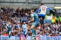 Glenn Murray of Brighton & Hove Albion jumps above Dan Burn of Wigan Athletic to head the ball - Mandatory by-line: Jason Brown/JMP - 17/04/2017 - FOOTBALL - Amex Stadium - Brighton, England - Brighton and Hove Albion v Wigan Athletic - Sky Bet Championship