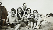 happy family scene on the beach 1950