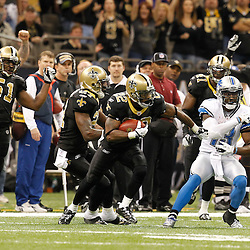 December 4, 2011; New Orleans, LA, USA; New Orleans Saints cornerback Tracy Porter (22) runs back an interception past Detroit Lions wide receiver Nate Burleson (13) during the second half of a game at the Mercedes-Benz Superdome. The Saints defeated the Lions 31-17. Mandatory Credit: Derick E. Hingle-US PRESSWIRE