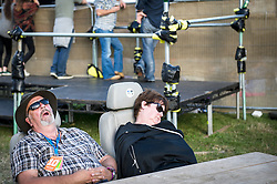 Exhausted festivalgoers at the Brownstock Festival in Essex.