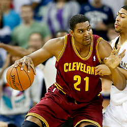 Nov 22, 2013; New Orleans, LA, USA; Cleveland Cavaliers center Andrew Bynum (21) against New Orleans Pelicans power forward Anthony Davis (23) during the first quarter of a game at New Orleans Arena. Mandatory Credit: Derick E. Hingle-USA TODAY Sports