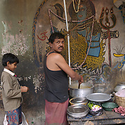 The Indian god Shiva painted on the wall next to a road side food stall in Kolkata