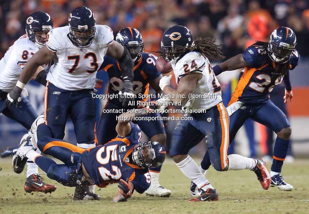Dec. 11, 2011 - Denver, Colorado, U.S - Denver Broncos LB WESLEY WOODYARD, lower left, strips the ball from Chicago Bears RB MARION BARBER, right, during OT to help his team go on to win the game over the Bears 13-10