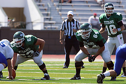 17 September 2011: Rob Gallik waits in the shotgun behind Nick Varchetto protected by Alex Bell during an NCAA Division 3 football game between the Aurora Spartans and the Illinois Wesleyan Titans on Wilder Field inside Tucci Stadium in.Bloomington Illinois.