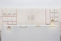 "VENICE, ITALY - 4 JUNE 2016: Plaster models of Renato Rizzi's ""Orphan Ground"" exhition are here at the 15th Venice Architecture Biennale in Venice, Italy, on June 4th 2016.<br /> <br /> Rizzi says: ""The four projects in section show us, beyond the concrete needs, the internal movements of invisible powers. The 118 models [of this exhibition] hang on the wall to show us how the matter is the aspiration to soul and vice versa."