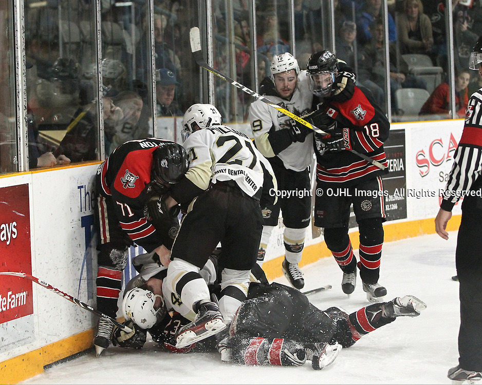 TRENTON, ON  - APR 15,  2017: Ontario Junior Hockey League, Championship Series. Georgetown Raiders vs the Trenton Golden Hawks in Game 2 of the Buckland Cup Final. Jonathan Hampton #71 of the Georgetown Raiders becomes involved in an altercation with Chays Ruddy #4 of the Trenton Golden Hawks as other players join in during the third period.<br /> (Photo by Tim Bates / OJHL Images)