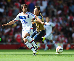 Mesut Ozil of Arsenal battles for the ball with Clement Grenier of Lyon  - Mandatory by-line: Joe Meredith/JMP - 25/07/2015 - SPORT - FOOTBALL - London,England - Emirates Stadium - Arsenal v Lyon - Emirates Cup