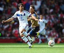 Mesut Ozil of Arsenal battles for the ball with Clement Grenier of Lyon  - Mandatory by-line: Joe Meredith/JMP - 25/07/2015 - SPORT - FOOTBALL - London,England - Emirates Stadium - Arsenal v Lyon - Emirates Cup
