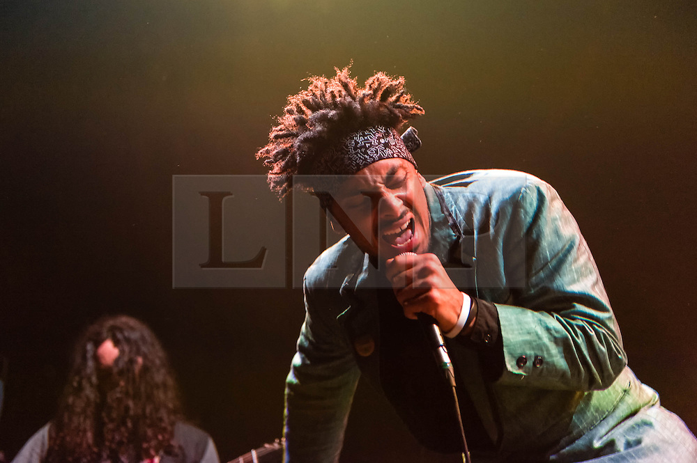 """© Licensed to London News Pictures. 27/05/2014. London, UK.   King Holiday performing live at The Roundhouse, supporting headliner Paloma Faith.   In this picture - Leslie 'Kujo' DuMouchel. King Holiday is an American 10-piece soul/psychedelic rock/jazz/funk  band led by founder Leslie 'Kujo' DuMouchel & consisting of members Leslie """"Kujo"""" DuMouchel (lead Vocals), Miles Spillane (Drums), Ben Lieberman (Guitar), Andrew Friedman (Bass), Chesney Pollis (Backing Vocals), Ngonda Badilla (Backing Vocals). Photo credit : Richard Isaac/LNP"""