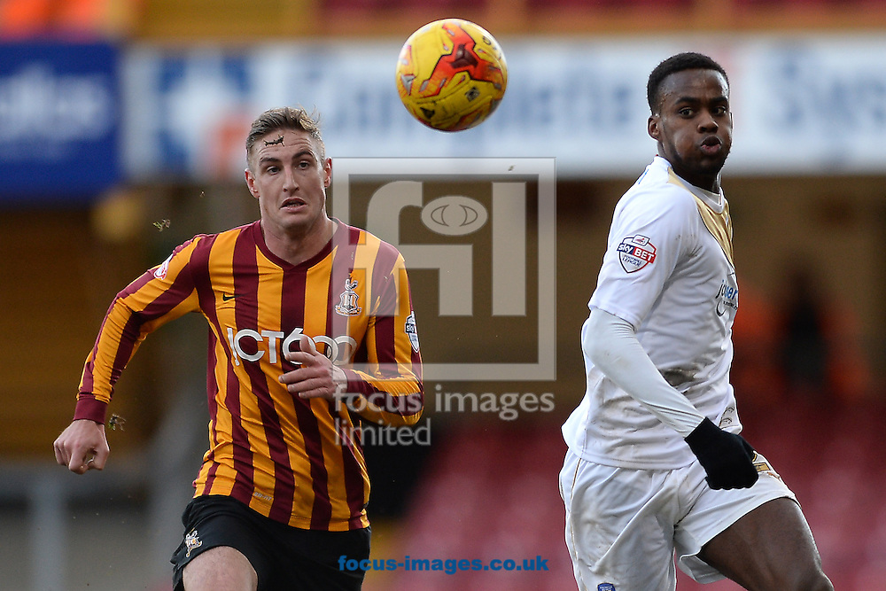 Gavin Massey of Colchester United does battle with Gary Liddle of Bradford City during the Sky Bet League 1 match between Bradford City and Colchester United at the Coral Windows Stadium, Bradford<br /> Picture by Richard Blaxall/Focus Images Ltd +44 7853 364624<br /> 31/01/2015