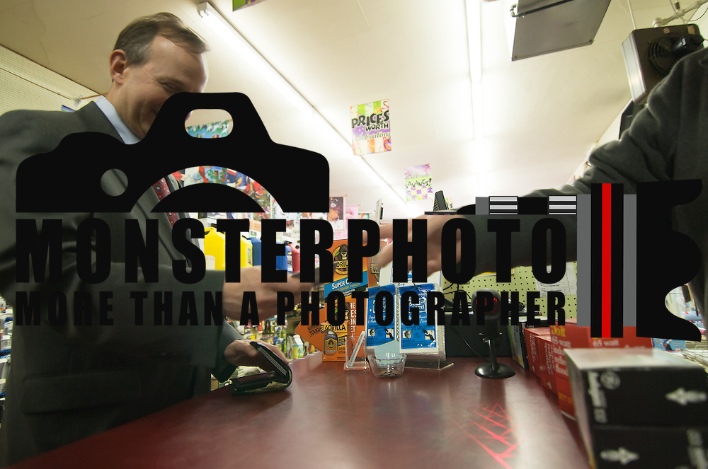 02/03/11Middletown DE: Delaware Governor Jack Markell &quot;left&quot; buys  lightbulbs from Middletown Hardware Store.  <br /> <br /> Hardware Store owner Jim Smyth &quot;Right&quot; passes Governor Jack Markell credit card back to him Thursday afternoon.<br /> <br /> Special to The News Journal/SAQUAN STIMPSON