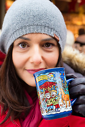 Woman drinking traditional Gluhwein at Christmas Market in Cologne Germany