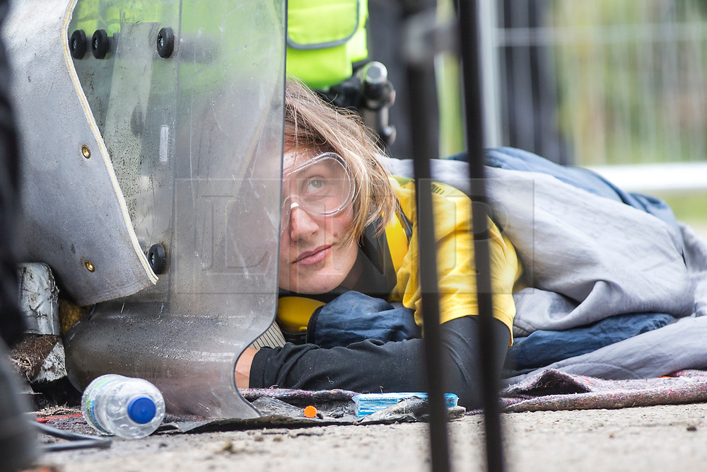 © Licensed to London News Pictures. 27/09/2017. Kirby Misperton UK. Police have called in a Protester Removal Team after two women chained themselves together outside the gates of the Kirby Misperton KM8 fracking site as Anti Fracking protests go into the 8th day. Third Energy was granted planning permission last year to frack the site but has not yet received final consent to begin fracking, but expects to start before the end of the year.Photo credit: Andrew McCaren/LNP