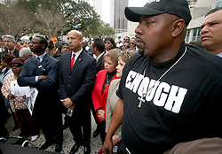 January 11 2007 - Protest against the violence, New Orleans. Surrounded by city councillors, Mayor Ray Nagin (center, bald head) listens to speakers denouncing the city's violence. Thousands of demonstrators from all over the city marched for peace in New Orleans to protest the spiraling murder rate. Many placards called for the police chief, Warren Riley to quit. Others demanded Mayor Nagin's resignation. <br /> Photo credit; Charlie Varley.