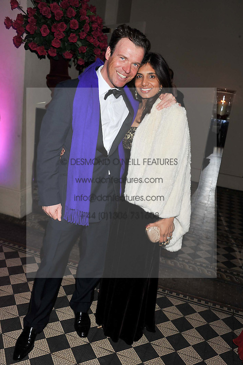 JOEL & DIVIA CADBURY at the Red & Black Valentine's Dinner & Dance in aid of The Eve Appeal at One Mayfair, North Audley Street, London W1 on 14th February 2013.