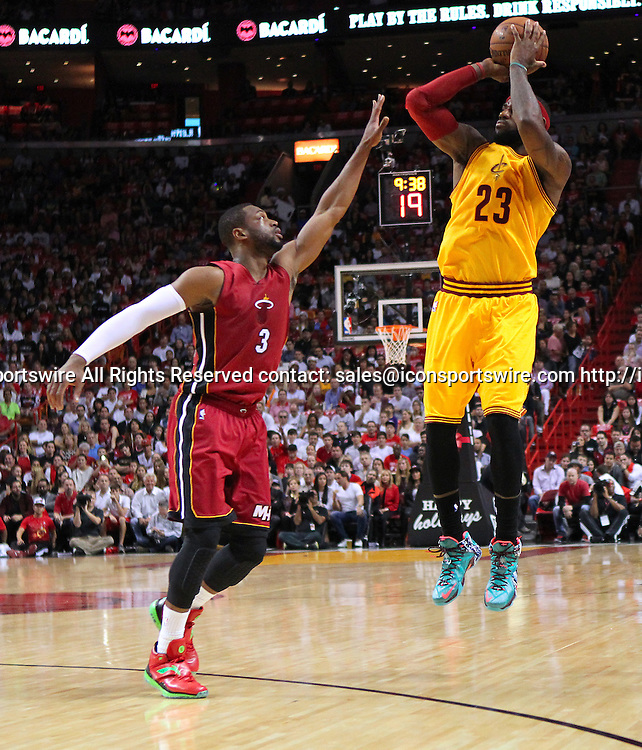 Dec. 25, 2014 - Miami, FL, USA - Cleveland Cavaliers forward LeBron James shoots over Miami Heat guard Dwyane Wade during the first quarter of an NBA basketball game on Dec. 25, 2014 at the AmericanAirlines Arena in Miami. The Heat won 101-91