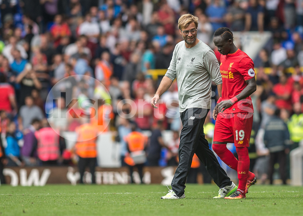 Jürgen Klopp manager of Liverpool and Sadio Mané of Liverpool talk after the Premier League match between Tottenham Hotspur and Liverpool at White Hart Lane, London, England on 27 August 2016. Photo by Vince  Mignott.
