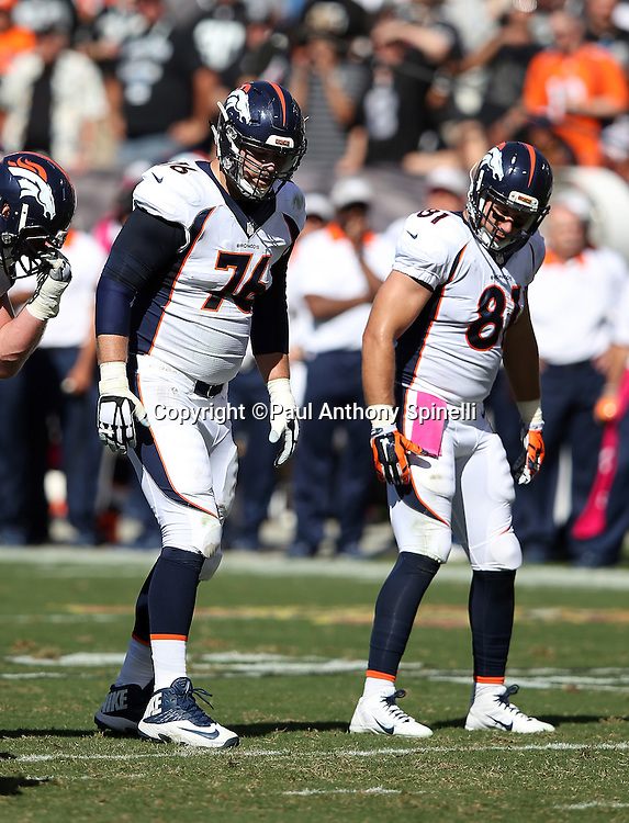 Denver Broncos offensive tackle Tyler Polumbus (76) and Denver Broncos tight end Owen Daniels (81) get set at the line of scrimmage during the 2015 NFL week 5 regular season football game against the Oakland Raiders on Sunday, Oct. 11, 2015 in Oakland, Calif. The Broncos won the game 16-10. (©Paul Anthony Spinelli)
