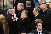 Congressmen Peter King takes a mobile phone photo as he waits for the start of the President Inaugural Ceremony on Capitol Hill January 20, 2017 in Washington, DC. Donald Trump became the 45th President of the United States in the ceremony.