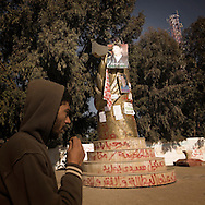 TUNISIA, SIDI BOUZID : A man looks at a portrait of Tunisian protest hero Mohammed Bouazizi in a street, in Sidi Bouzid. Mohammed Bouazizi set himself alight on a cart in a protest against police oppression. Copyright Christian Minelli.