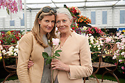 KATHERINE GRIMOND AND HER MOTHER VANESSA REDGRAVE WITH THE NATASHA RICHARDSON ROSE, PRESS PREVIEW. The RHS Chelsea Flower Show 2011. The Royal Hospital grounds. Chelsea. London. 23 May 2011. <br /> <br />  , -DO NOT ARCHIVE-© Copyright Photograph by Dafydd Jones. 248 Clapham Rd. London SW9 0PZ. Tel 0207 820 0771. www.dafjones.com.