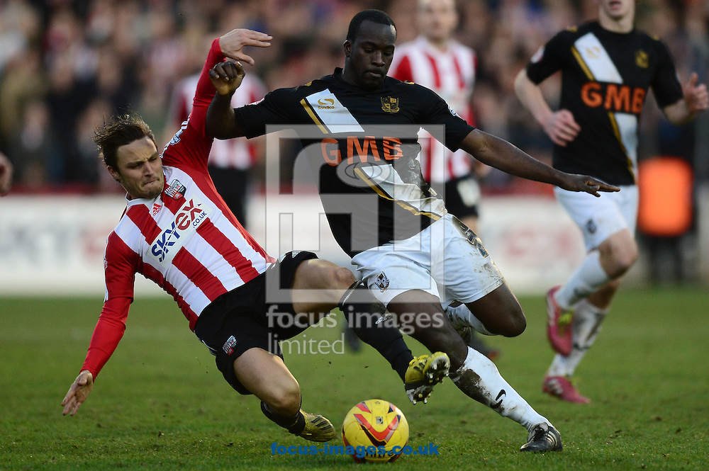 Picture by Alex Broadway/Focus Images Ltd +44 7905 628183<br /> 11/01/2014<br /> Sam Saunders of Brentford of Brentford and Anthony Griffith of Port Vale of Port Vale during the Sky Bet League 1 match at Griffin Park, London.