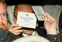 © Licensed to London News Pictures. 06/02/2019. London, UK. A guest covers his face with an invitation as he arrives at Battersea Park in London for the annual Black and White Ball, a fundraiser held by the Conservative Party. Photo credit: Ben Cawthra/LNP