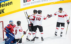 Thomas Rufenacht of Switzerland, Cody Almond of Switzerland, Reto Schappi of Switzerland and Romain Loeffel of Switzerland celebrate after scoring first goal during the 2017 IIHF Men's World Championship group B Ice hockey match between National Teams of Norway and Switzerland, on May 7, 2017 in Accorhotels Arena in Paris, France. Photo by Vid Ponikvar / Sportida