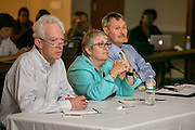 """These are judges: Robert Ambrogi, left, K. Krasnow Waterman and Glen Rawdon at the  """"Hackness to Justice 2014 Hackathon"""" session at the 2014 annual meeting of the American Bar Association in Boston at Suffolk University Law School.  photo by Kathy Anderson"""