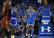 Feb 28, 2019; Los Angeles, CA, USA; UCLA Bruins guard Jaylen Hands (4) celebrates with guard David Singleton (34) after a 3-point basket in the final minute of overtime against the Southern California Trojans at Pauley Pavilion. UCLA defeated USC 93-88 in overtime.