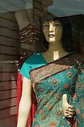 Caucasian mannequin wearing an Indian sari in a shop window on Gerrard Street in Toronto's Indian Bazaar neighborhood.