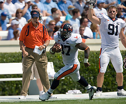 Virginia head coach Al Groh and Virginia defensive end Chris Long (91) watch Virginia running back Cedric Peerman (37) as he rushed for 186 yards against UNC.  The North Carolina Tar Heels football team faced the Virginia Cavaliers at Kenan Memorial Stadium in Chapel Hill, NC on September 15, 2007.  UVA defeated UNC 22-20.