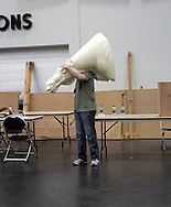 An unknown man holds a elk mannequin inside the tradeshow