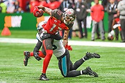 Tampa Bay Buccaneers Wide Receiver Mike Evans (13) is tackled during the International Series match between Tampa Bay Buccaneers and Carolina Panthers at Tottenham Hotspur Stadium, London, United Kingdom on 13 October 2019.