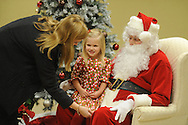 Family Crisis Services' Milk and Cookies with Santa in Oxford, Miss. on Thursday, December 5, 2013. Addy Photography provided photography of the event.